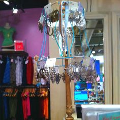 This is a lamp with just the wire framing from the shade and it serves as an earring rack! You can even spin it! Such a neat idea!!