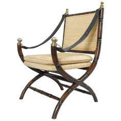 Drexel Campaign Style Faux Bamboo Chair Safari Sling Arm Hollywood Regency | From a unique collection of antique and modern armchairs at https://www.1stdibs.com/furniture/seating/armchairs/