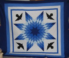 Made by Diane's Native American Star Quilts (Diane Hill) and quilt by a close friend. This is called An Alaskan Star. Made for someone special.