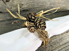 Pine Cone and Grapevine Twig Napkin Rings for Christmas, Holiday and Winter (Set of 4, 6, 8, 10, 12). Handcrafted natural grapevine napkin rings for autumn and winter celebrations. These rustic napkin rings are made of natural grapevine twigs, real mini pine cones and straw raffia. They are the perfect touch for your rustic Thanksgiving or Christmas table. You can choose your set size during checkout. ***Made to order so they will have their own unique variations from those shown....