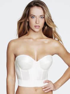 Dominique 6377Get the support and comfort you crave in this low back romanticcorset-style bra. Sweetheart neck helps shape and slim. Essential for strapless gowns. Soft stretch allows for secure comfortable movement. Dare to bare.Product AdvantagesSeamless contour underwire cups are lightly padded for subtle enhancement.Boning throughout provides shape and support.Low back design is great with low cut dresses.Elastic straps are versatile and can be worn regular halter criss-cross or…