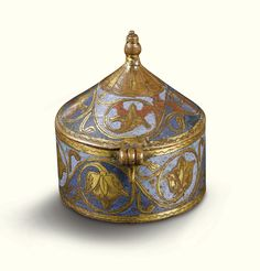 FRENCH, LIMOGES, CIRCA 1220-1230  PYX WITH SCROLLING VINES gilt and champlevé enamelled copper