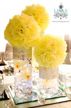 White pomander/kissing/ball/flower ball wedding centerpieces by LUXE Weddings and Events www.eventsbyluxe.com