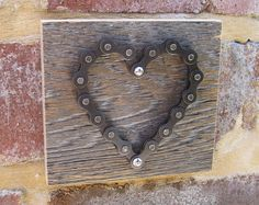 Bicycle chain heart on oak