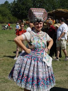 "Kroje (pronounced ""kroy-eh"") (singular: kroj) are folk costumes worn by Czechs and Slovaks. Gothic influence is seen in tying shawls and kerchiefs on the head. Fine pleats and gathered lace collars typify the Renaissance era. From Baroque bell-shaped skirts to delicate oriental patterns borrowed from Turkish invaders, these folk costumes show the complex growth of the Czech and the Slovak traditions."