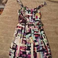 Cute summer dress, almost brand new! Fun color print dress perfect for spring/summer. Size 6, sleeveless, slightly above knee length. Comes with sash to tie around waist but removable. Only worn once - so cute and comfortable! Ali Ro Dresses Mini