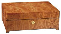 Exotic Bubinga Burl Large Jewelry Box. h1Exotic Bubinga Burl Large Jewelry Box_h1The Exotic Bubinga Burl Large Jewelry Box is crafted for your pleasure to house your precious jewels. Plenty of storage space, compartments, and key lock.. See More Jewelry Boxes at http://www.ourgreatshop.com/Jewelry-Boxes-C1090.aspx