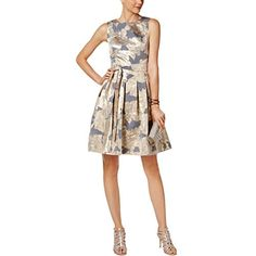 97c8028f8c7 Chic and flirty, this Tommy Hilfiger dress glistens in metallic blossoms  and features a pretty sash tied around the narrowest part of the waistline.