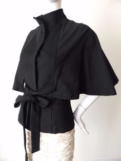 Honey Beau Jacket Size 8 OR US 4 Black | eBay This Honey & Beau jacket is designed in a cape style. It has a mandarin style collar with top stitching and top stitching and seaming detail on the front and back. It has five hidden snap button closures and a self styled belt which can be tied up at the front or back. It has elbow length kimono style sleeves. It is unlined. Size 8 or US 4. The material has stretch.