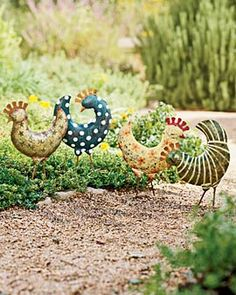 "Strutting through the vegetable patch or pecking around your flowerbeds, our funky folk-art poultry are simply irresistible. Each ""flock"" member is individually hand-painted and will age to a pleasing, rusty patina when left outdoors."