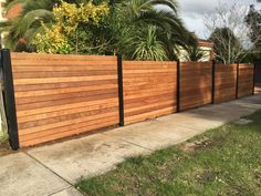 Merbau front feature fence, steel posts, horizontal merbau front fence, timber fencing