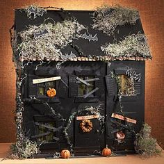 Give new life to an old dollhouse by transforming it into a mini haunted house