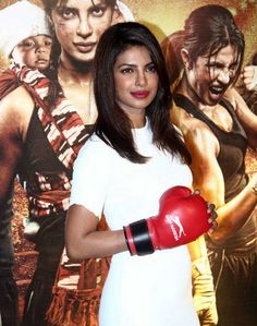 Priyanka Chopra in white dress at MARY KOM film Premier as the boxer in her latest film