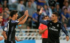 Asensio high fives team-mate Morata after his goal put Real in a very comfortable position against Real Sociedad