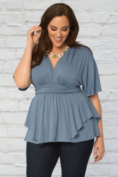 With its flowy sleeves and soft, feminine feel, our plus size Promenade Top in Serenity Blue is your getaway go-to! Get more inspiration with our made in the USA fashions at www.kiyonna.com. #kiyonnaplusyou