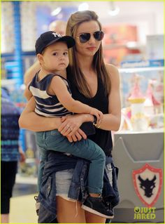 Miranda Kerr takes her son Flynn shopping at FAO Schwarz on July 28, 2013