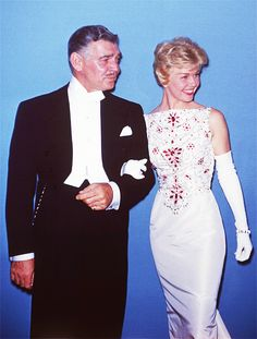 3/30/14  5:16a  The Academy Awards Ceremony 1958:  Clark Gable and Doris Day  Presenters: Screenplay Category for 1957   Doris Day wears a  Lovely Simple White Gown  topped my  Ruby Encrusted Stones.