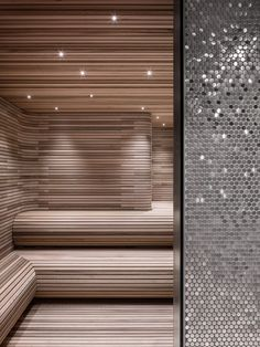 A steam room lined with thin horizontal strips of wood at 56 Leonard by Herzog & de Meuron