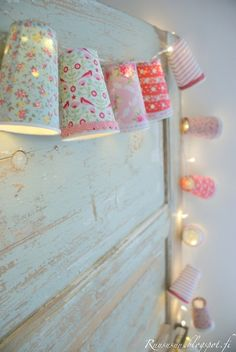 Greengate.  There's gotta be a way to DIY this. Greengate design patterns are great but I'm thinking I can find chandelier shades and some great scrapbook paper or fabric and a string of lights and make my own.