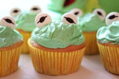 Kermie cupcakes: Mentos and edible marker for the eyes (They're not drawn right.) Google Image Result for http://simplybeingmommy.com/wp-content/uploads/2011/11/kermit-the-frog-small.jpg