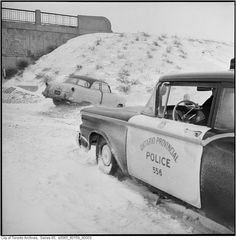 OPP helping out in 1960 on the QEW, Toronto.