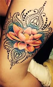Lotus flower on buttcheek with mandala lace extending to cover scars