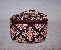 Jewelry Travel Case in Medallion  by Vera Bradley      Delightful multi-use travel jewelry case has full open interior, zip-around lid and carry handl