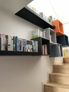small home library using ikea eket & lack. book shelf, stairs