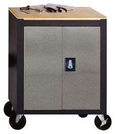 Metal Box Industries COS-SVMC MBI Garage Storage System - Mobile Cabinet, Silver/Black by Edsal. $274.99. From the Manufacturer                Four swivel casters conveniently transport this cabinet to any working area. All welded steel construction for lasting strength and durability. Attractive silver/black hammertone powder coated doors and textured black powder coated cabinet. Doors have full height reinforcements and strong piano hinges for rigidity and smooth ope...