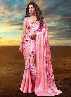 This delightful diva accoutre features unique styling and unusual material. This pink satin and faux crepe designer saree add the sense of elegant and glamorous. The brilliant attire creates a dramati...