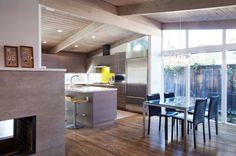 bright, well-lit kitchen in this 1960s home, designed by Brown and Kaufman, and by Klopf Architecture