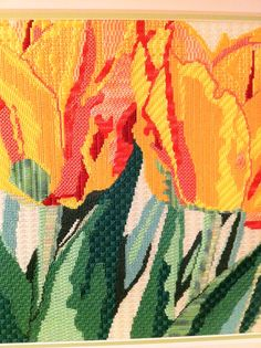 Great use of stitches for a traditional Jean Smith Tulip needlepoint canvas.