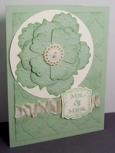handmade wedding card ... pale green and cream ... like the texture and sponged edges on the petals ... big flower with several layers ... light tone on tone inking on the embossing folder background ... beautiful ... Stampin' Up