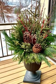"""The deep bowl of 23"""" Crescendo urn is ideal for big holiday arrangements such as this beautiful red & green design by expert June Spanier! The TierraVerde planters are made of recycled rubber, from used car tires diverted from landfill. Ecofriendly, plant safe, and durable, these planters are a perfect choice for winter designs because they are tested to -40 degrees and won't crack! Use cedar as a base, pine branches, winter berry and willow for height. Embellish with pine cones, and… Pine Branch, Branches, Christmas Planters, Christmas Wreaths, Rubber Material, 40 Degrees, Recycled Rubber, Pine Cones, Urn"""