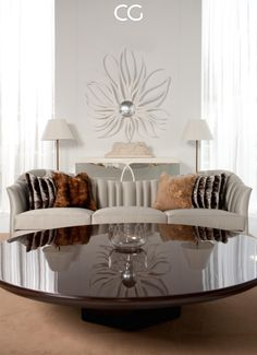 Stylish sitting area in this sunlit living room decorated with Christopher Guy most luxurious accessories #christopherguy #luxury #lifestyle