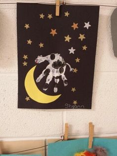 Preschool Hey Diddle Diddle art project. Cow jumping over the moon with their hand prints.