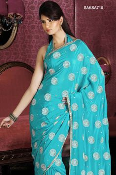 Google Image Result for http://www.cbazaar.com/images/prd_img_b/Embroidered-Turquoise-Blue-Crepe-Saree-SAKSA710-b.jpg