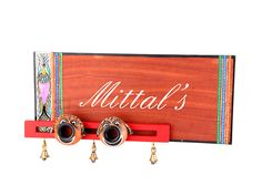 This ethnic nameplate is made out of mango wood . Nazar Bhattu's are a proven technique to ward off evil spirits and keep one's home, kith and kin, safe and well. When placed at the entrance, this name plate accords a classy yet traditional look to your house.