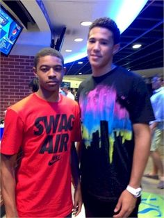 Tyler Ulis and Devin Booker at the UK Alumni Game