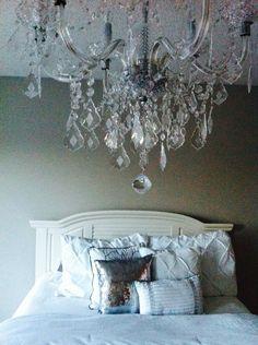 Bedroom: White duvet, sequin pillows, crystal chandelier