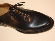 Lugus Mercury Black Calf with Tan Piping Seamless Custom Men's Shoe  - This custom made men's shoe is seamless, being created from one solid piece of black French calf.    The constrast of the tan piping and tan kangaroo lining finish the polished look.