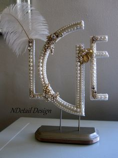 Wedding Cake Topper & Display OOAK Triple Monogram with Ivory Pearls, Gold Jewelry and Ostrich Feather for Gatsby
