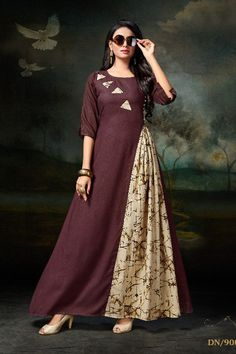 Make an elegant statement at the next get together in lilac layered tunic this festive season. Silk Kurti Designs, Kurti Designs Party Wear, Designer Party Wear Dresses, Indian Designer Outfits, Dress Neck Designs, Blouse Designs, Printed Gowns, Dress Patterns, Fashion Dresses