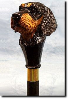 Dachshund Wire Hair Dog Walking Stick. The Dachshund Wire Hair Dog Walking Stick is a reproduction of an original woodcarving by Michael Park, a Master woodcarver, recognized worldwide for his detailed carvings and reproductions. Michael's passion and love for dogs are evident in his outstanding workmanship.