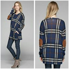 The London Tunic sizes S M L XL The London Tunic in a cool blue plaid style Features tan shoulder patch Material is polyester and spandex  Size Available S M L XL  PLEASE INDICATE which size you want  Price Firm unless bundled  Follow on Facebook Sweet-bb  Nwot Tops Tunics