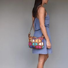 Woman wearing a multi coloured , handmade leather cross body bag with on her shoulder. Front Design, Handmade Leather, Leather Crossbody Bag, Tan Leather, Cross Body, Shoulder Strap, Women Wear, Woman, How To Wear