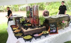 TACO STATION: Tacos are a versatile crowd pleaser and are well suited to stations. This station features chicken and fish tacos, with a variety of toppings and mini hibiscus margaritas.