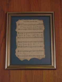 Antiqued Hymn Sheet Music in Frame
