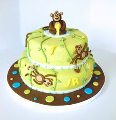 Monkey Birthday 2 Tier cake with handmade fondant Monkey topper. Fondant topping and Buttercream filling.