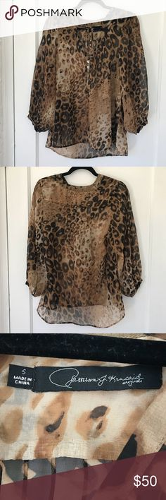Patterson J. Kincaid leopard blouse bell sleeve Patterson J. Kincaid leopard print blouse with on trend  bell sleeve. Very flattering! Is slightly sheer but opaque enough you wouldn't have to wear a tank underneath. In excellent worn condition. No stains, rips or snags.  Only selling because I had to down size my closet. This is a beautiful piece that is very versatile – don't miss out! Patterson J. Kincaid Tops Blouses